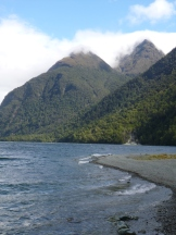 A chilly evening with waves and wind sweeping off Lake Gunn, the last DOC campground on the road to Milford Sound